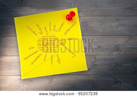 Business plan against yellow pinned adhesive note