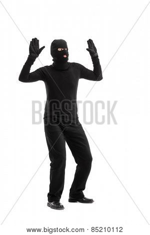 Full length portrait of a thief surrendering to someone isolated on white background