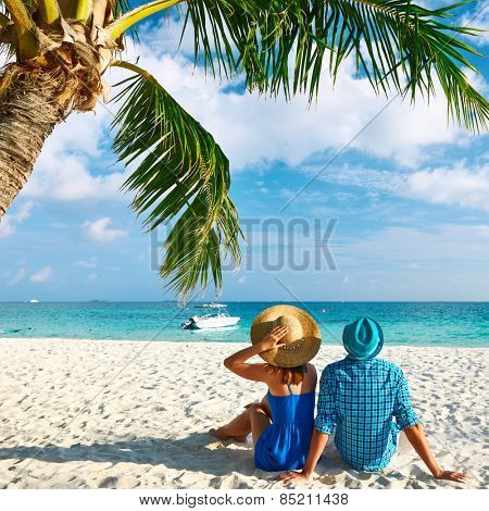 Couple in blue clothes on a tropical beach at Maldives