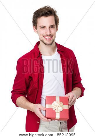 Smiling man in red shirt with gift box