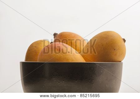 Popular Indian Alfonso mangoes. Whole mangoes placed in a bowl.