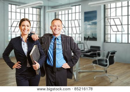 Two happy business people standing in a modern loft office (3D Rendering of background)