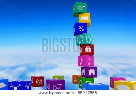App cubes against blue sky over clouds at high altitude