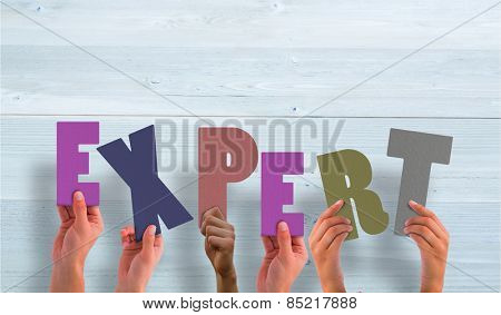 Hands holding up expert against bleached wooden planks background