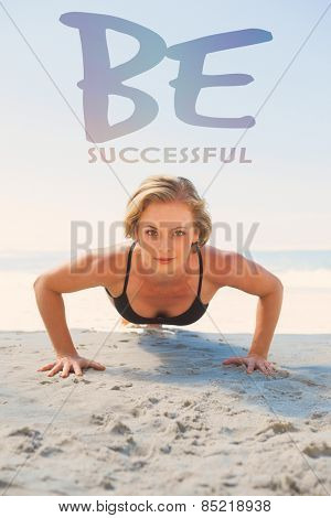 Fit blonde in plank position on the beach against be succesful