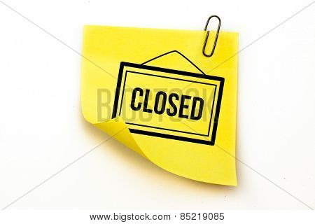 Closed sign against sticky note with grey paperclip