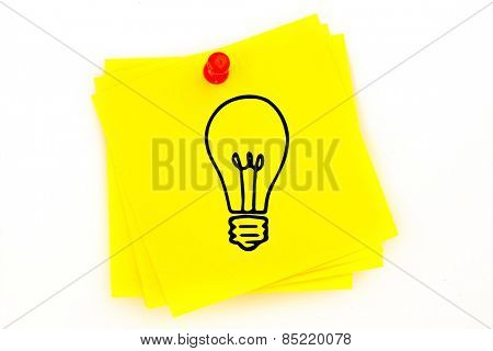 Light bulb against sticky note with red pushpin
