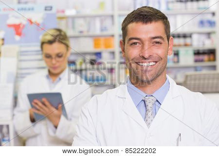 Happy pharmacist looking at camera at the hospital pharmacy