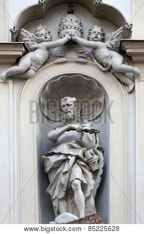 VIENNA, AUSTRIA - OCTOBER 10: Statue of Saint Peter, facade of the presbitory of the Saint Peter Church in Vienna, Austria on October 10, 2014.