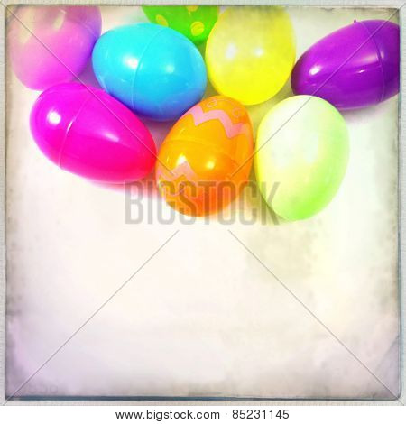 Instagram filtered image, close up of plastic easter eggs with grain