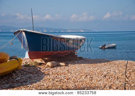 Blue-red Boat On The Beach