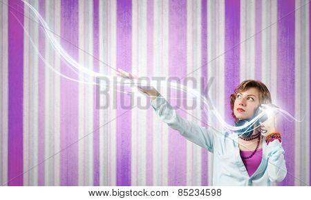 Young woman wearing headphones and enjoying music