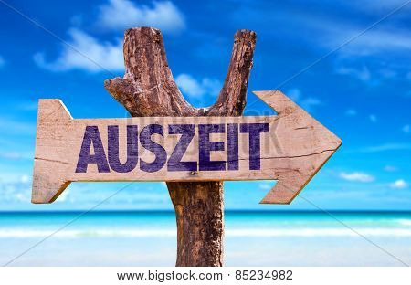 Time Out (in German) wooden sign with beach background