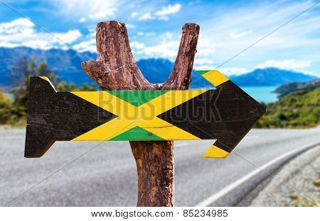 Jamaica Flag sign with road background