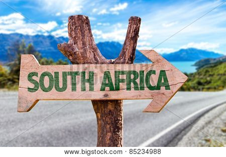 South Africa wooden sign with road background