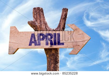 April wooden sign with sky background