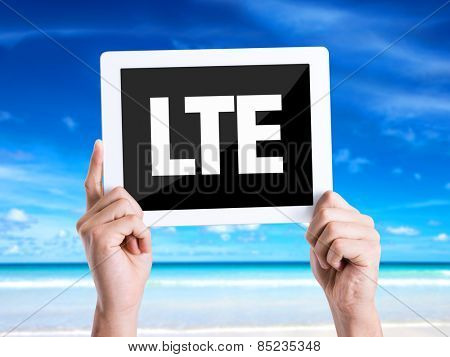 Tablet pc with text LTE with beach background