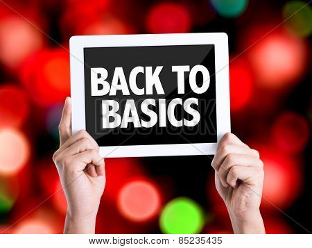 Tablet pc with text Back to Basics with bokeh background