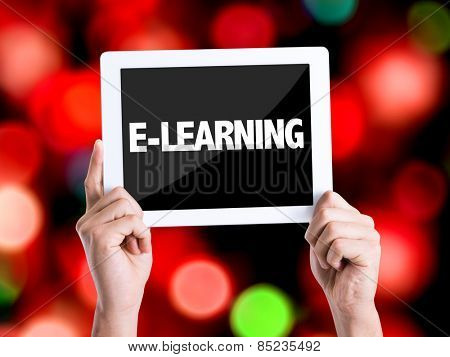 Tablet pc with text E-Learning with bokeh background