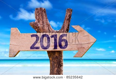2016 wooden sign with beach background