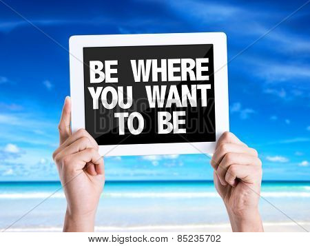 Tablet pc with text Be Where You Want To Be with beach