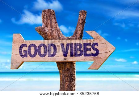 Good Vibes wooden sign with beach background