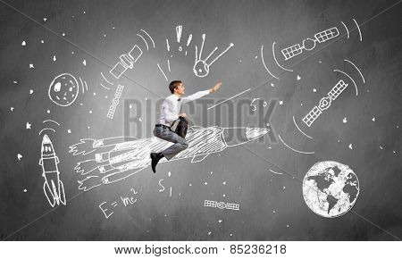 Young businessman flying in sky on drawn rocket
