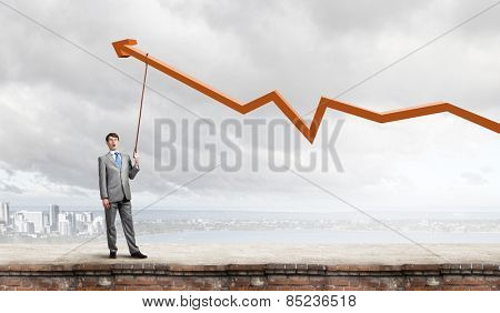 Young businessman pulling increasing graph with rope