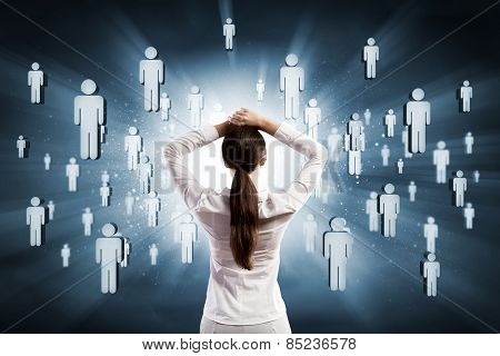 Rear view of businesswoman with hands on head thinking something over
