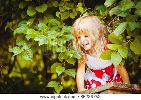 Cute little girl walking in the Park on a summer day