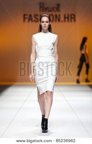 ZAGREB, CROATIA - OCTOBER 18, 2014: Fashion model wearing designer clothes on the 'Fashion.hr' fashion show