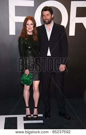 LOS ANGELES - FEB 20:  Julianne Moore & Bart Freundlich arrives to the Tom Ford Autumn/Winter 2015 Womenswear Collection Presentation  on February 20, 2015 in Hollywood, CA