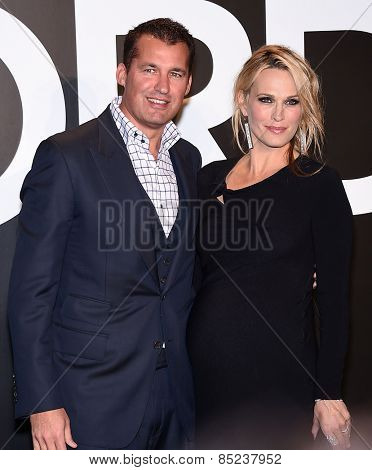 LOS ANGELES - FEB 20:  Molly Sims & Scott Stuber arrives to the Tom Ford Autumn/Winter 2015 Womenswear Collection Presentation  on February 20, 2015 in Hollywood, CA