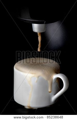 Coffee machine pouring hot espresso coffee in cup