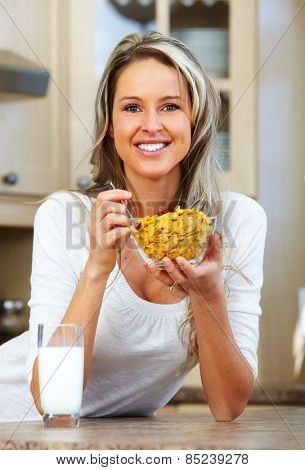 Young woman eating cereals. Healthy diet and nutrition.