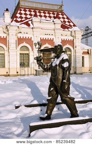YEKATERINBURG, RUSSIA - JANUARY 1, 2015: Sculpture of railway worker in front of Museum of Sverdlovsk railway. The museum located in the building of first railroad station of Yekaterinburg