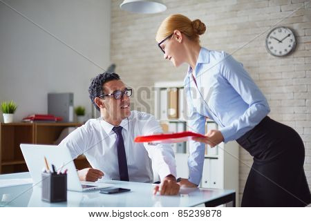 Pretty secretary flirting with colleague