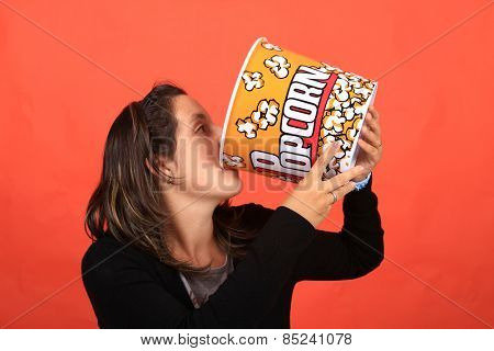 pretty young woman holding a pop corn bowl