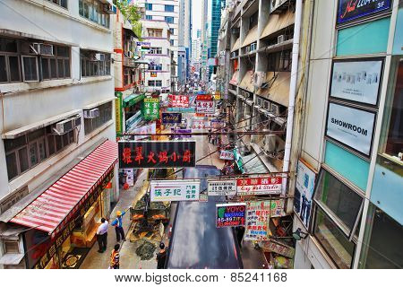 HONG KONG - DECEMBER 11, 2014: Hong Kong Special Administrative Region. Construction work on a narrow street in Hong Kong