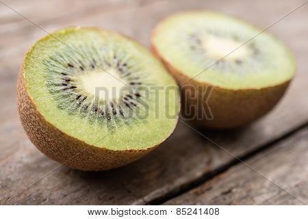 Kiwi on wooden background