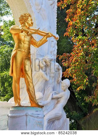 Waltz King. Gorgeous gilded statue of Johann Strauss with violin