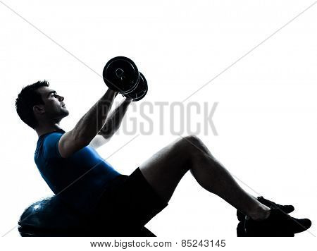 one  man exercising weight training on bosu workout fitness in silhouette studio isolated on white background