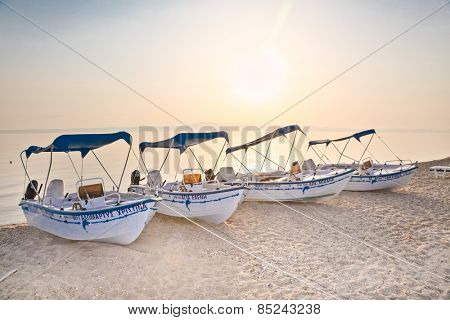 POLYCHRONO, GREECE - MAY 26, 2014 :Boats on beautiful sandy beach on May 26. 2014 in Polychrono, Kasandra peninsula , Greece. Kasandra peninsula visit more than 200 000 European tourists every year.