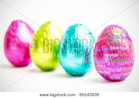 Happy easter in different languages against four easter eggs in a row