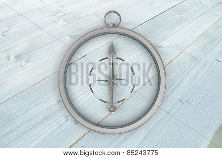 Compass against bleached wooden planks background
