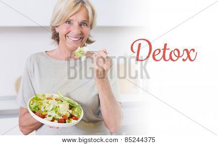 The word detox against smiling woman eating salad
