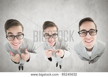 nerdy businessman showing thumbs up against white and grey background