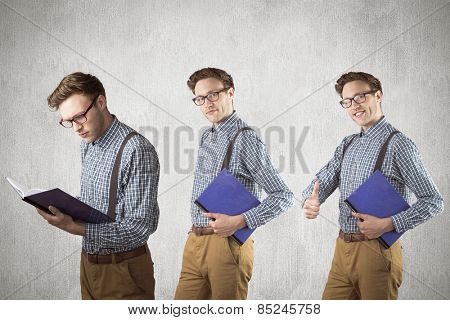 Nerd with notebook against white and grey background