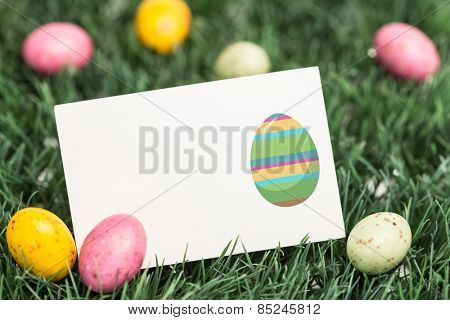 easter egg against blank greeting card with easter eggs