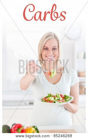 The word carbs against blonde woman offering salad